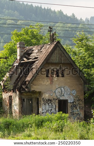 Old abandoned stone house with a leaky wooden roof in Slovakia, in the north-west. Green vegetation and hills around - stock photo