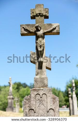Old, abandoned stony Orthodox crosses - stock photo