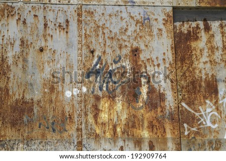 old abandoned train station, rusty iron walls - stock photo
