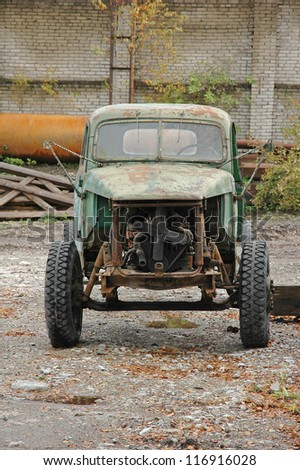 Old abandoned truck at factory - stock photo