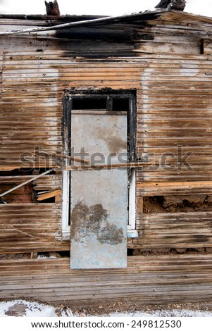 Old abandoned window, detail of a window of a house in ruins, evictions and abandonment, crisis. Astrakhan, Russia. - stock photo
