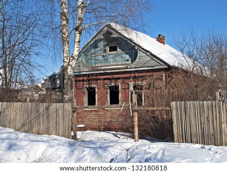 Old abandoned wooden house, winter time