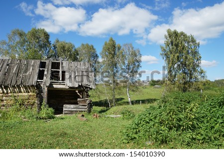 Old abounded wooden house in a village - stock photo
