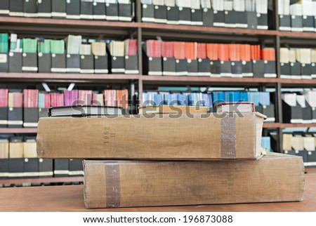 Old academic books and journals in library - stock photo