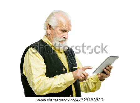 Old active bearded man with digital tablet isolated on white background - stock photo