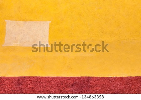 Old adobe wall abstract background. Textured fragment of painted wall. Architecture background. - stock photo