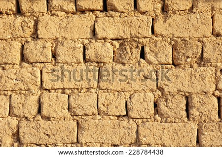 Old adobe wall closeup in sunny day