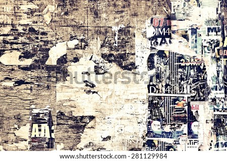 Old Advertising Wood Billboard With Torn Posters - stock photo