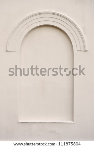 Old aged plastered faux arch false fake window stucco frame background copy space, light beige sepia texture - stock photo
