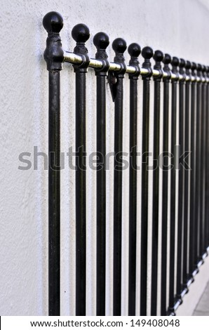 Old aged steel fence - stock photo