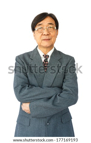 old aged thai businessman with glasses is standing and looking on white background(isolated)