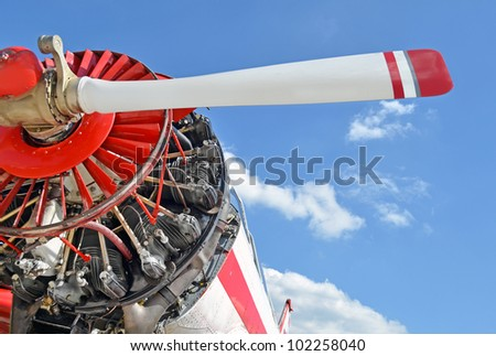 Old aircraft against blue sky, aircraft engine close up - stock photo