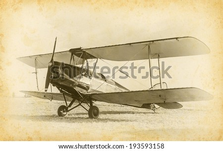 Old airplane at the airfield. Air travel with biplane - concept of retro aviation. Retro image of old aircraft. Vintage airplane closeup. - stock photo