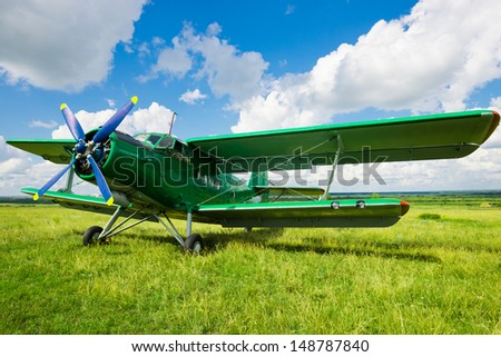 old airplane on green grass - stock photo