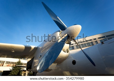 Old airplane propeller engines against bright blue sky - stock photo
