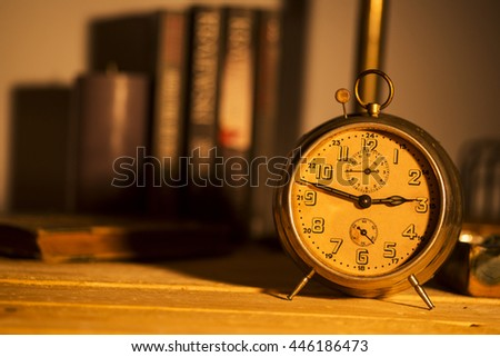 old alarm clock on background