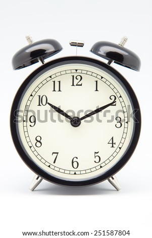 old alarm clock on white - stock photo