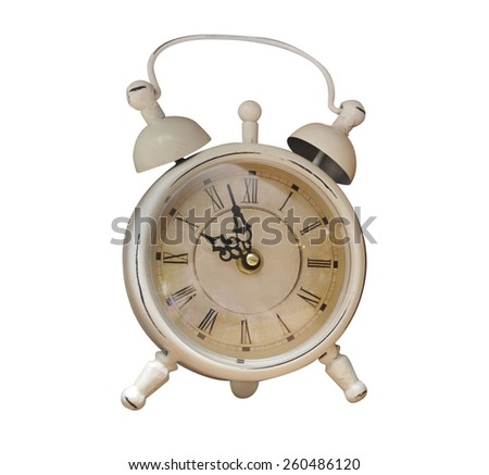 old alarm clock on white background - stock photo