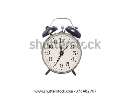 old alarm clock on white background