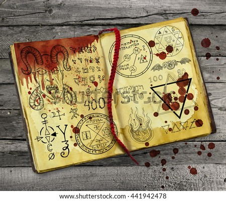 Old alchemy book with bloody hand print and drops lying on wooden table. Halloween still life, black ritual with occult and esoteric symbols - stock photo