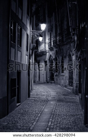 Old alley from Oporto by night. High ISO photo. - stock photo