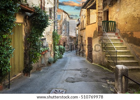 Old alley in a beautiful medieval town, Sarteano in Tuscany, Italy.
