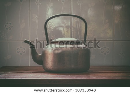 old aluminium kettle.vintage tone - stock photo