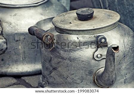 old aluminum kettle, vintage retro style image - stock photo
