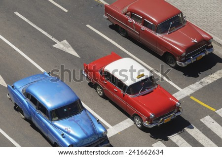 Old American cars on the road in Cuba. - stock photo