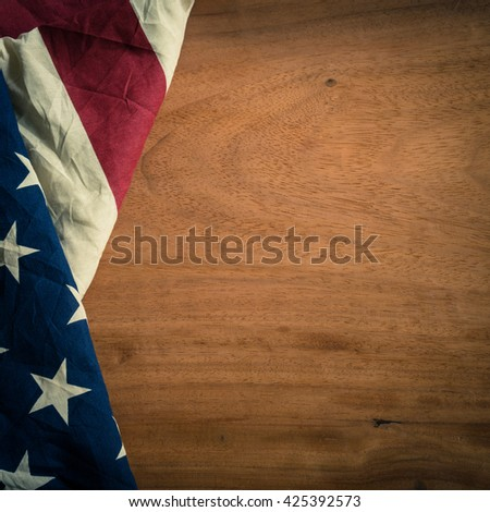 Old American flagon wood background for Memorial Day or 4th of July or Dependence Day, effect by vintage style, vintage image, vintage tone