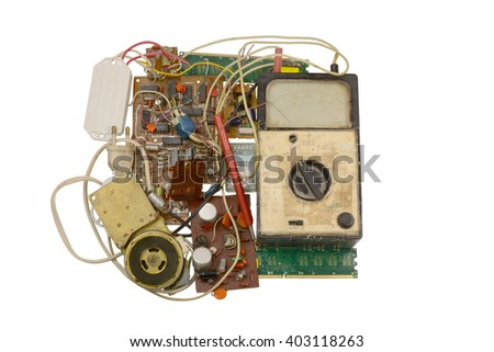 old ammeter and electronic components , printed circuit boards
