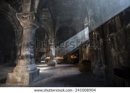 Old ancient Armenian christian church interior with amazing natural light. Geghard Monastery, 12 century - stock photo