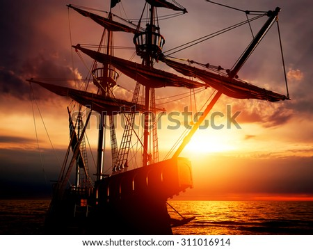 Old ancient pirate ship on peaceful ocean at sunset. Calm waves reflection, sun setting. - stock photo