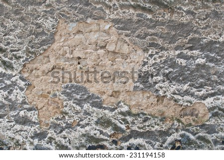 Old ancient rendered gray white neutral limestone wall - stock photo