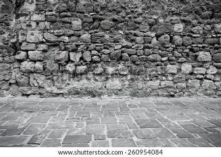 Old ancient stone wall and floor texture background - stock photo
