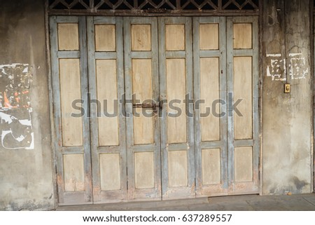 Old ancient wooden swing door background. Vintage of old wooden folding  doors texture. Antique - Folding Doors Stock Images, Royalty-Free Images & Vectors