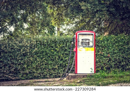Old and abandoned fuel distributor in vintage style, - stock photo