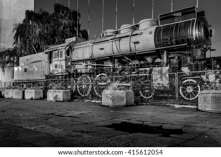 Old and abandoned locomotive in black and white - stock photo