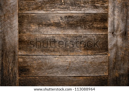 Old and antique wood plank board grunge background made of aged and weathered vintage barn wood with worn grain and texture - stock photo