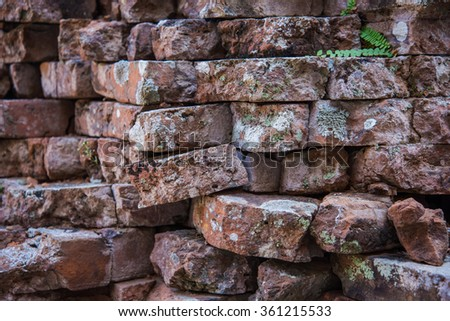 Old and broken red stone brick wall, close up details background, High definition
