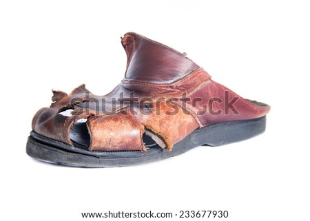 Old and broken shoe. White background - stock photo