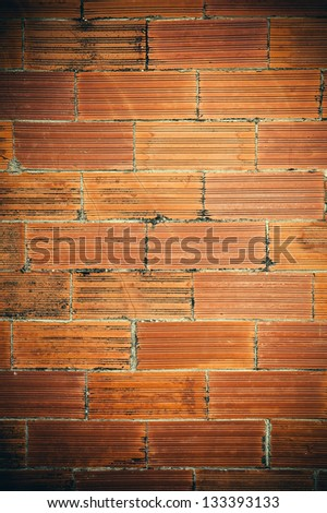 Old and damaged brick wall making background.