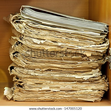 Old and damaged paper dossiers on heap - stock photo