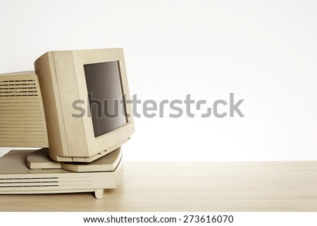 old and dirty personal computer on desktop. - stock photo