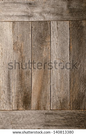 Old and distressed gray wood plank boards wall in an antique rural barn as an aged and weathered rustic background - stock photo