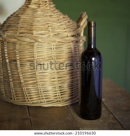 Old and dusty wine bottle  - stock photo