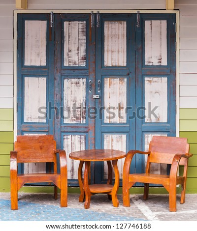 Old and grunge wood chairs and wood wall