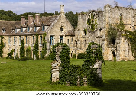 Old and luxurious Abbaye de Vaux de Cernay in Chevreuse valley in France.  - stock photo