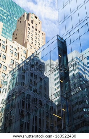 Old and modern office buildings reflections.  - stock photo