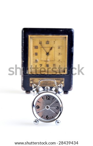 old and new clock against white - stock photo